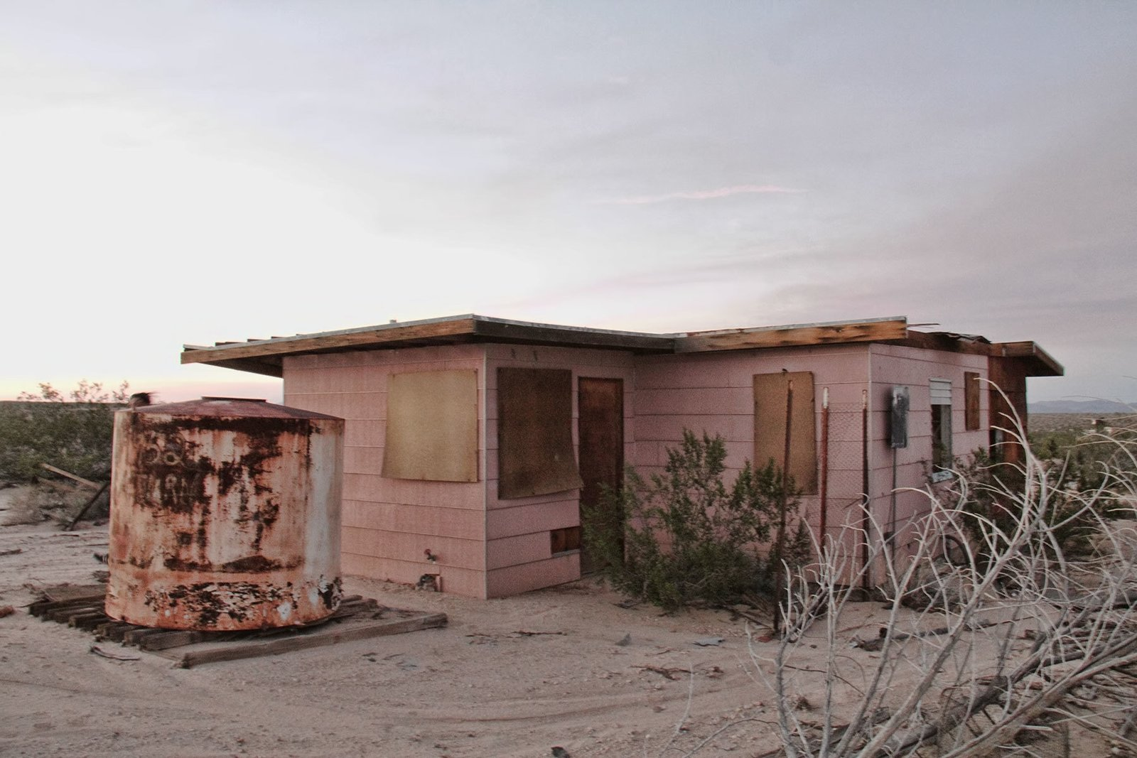 The condition of the home when the Smirkes purchased it in 2015.  Photo 1 of 21 in Experts Reveal the Top 10 Things to Consider Before Investing in a Fixer-Upper from A Couple Buy a Collapsing Cabin For $7K in Joshua Tree and Revamp it Into a Desert Oasis