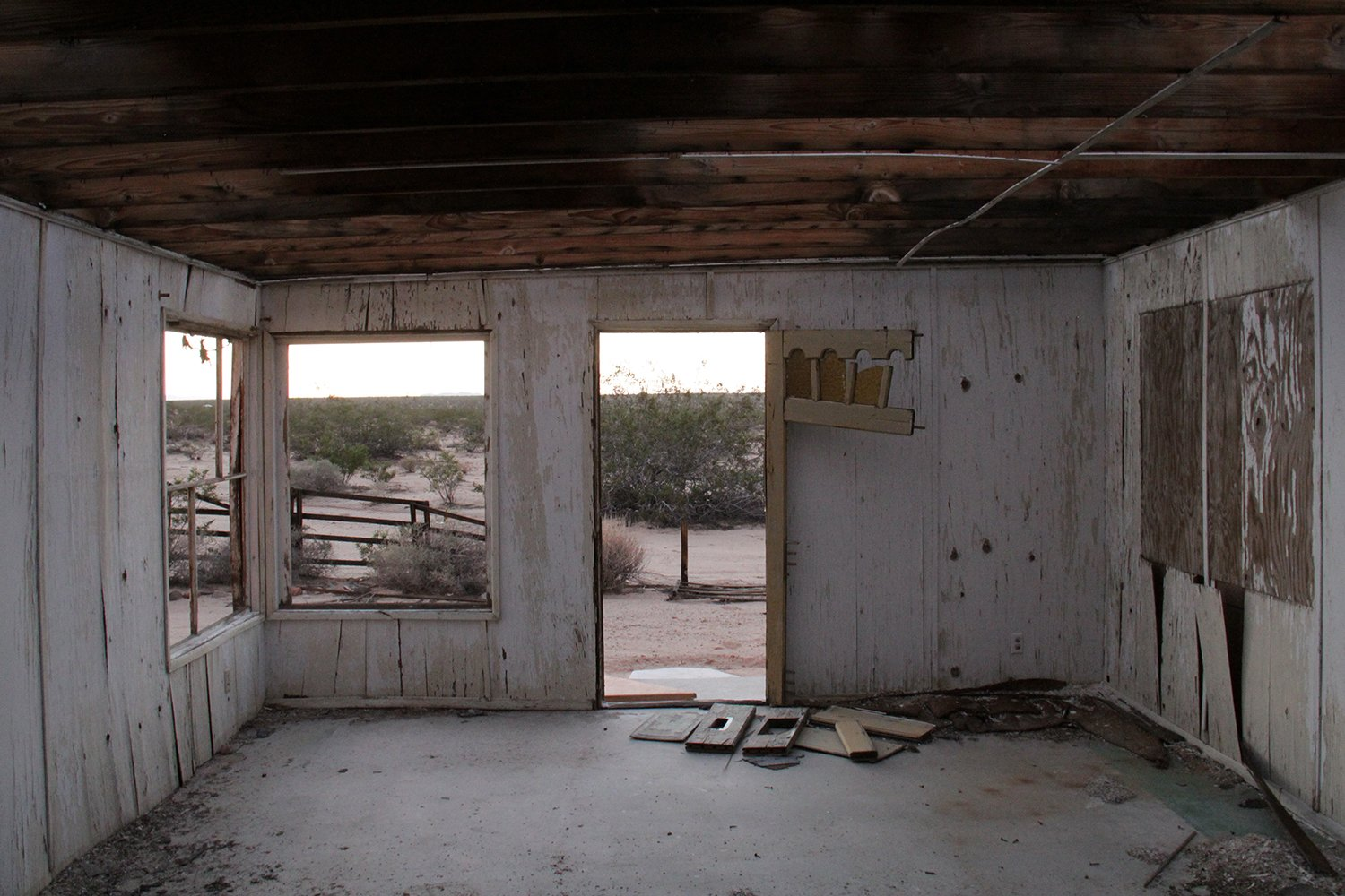 The interiors at the time of the purchase.  Photo 2 of 21 in Experts Reveal the Top 10 Things to Consider Before Investing in a Fixer-Upper from A Couple Buy a Collapsing Cabin For $7K in Joshua Tree and Revamp it Into a Desert Oasis