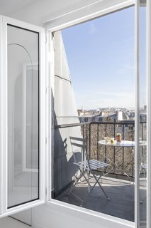 A small balcony reveals stunning views of the city.