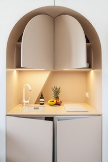 Pop-out doors reveal storage space and a tiny refrigerator.