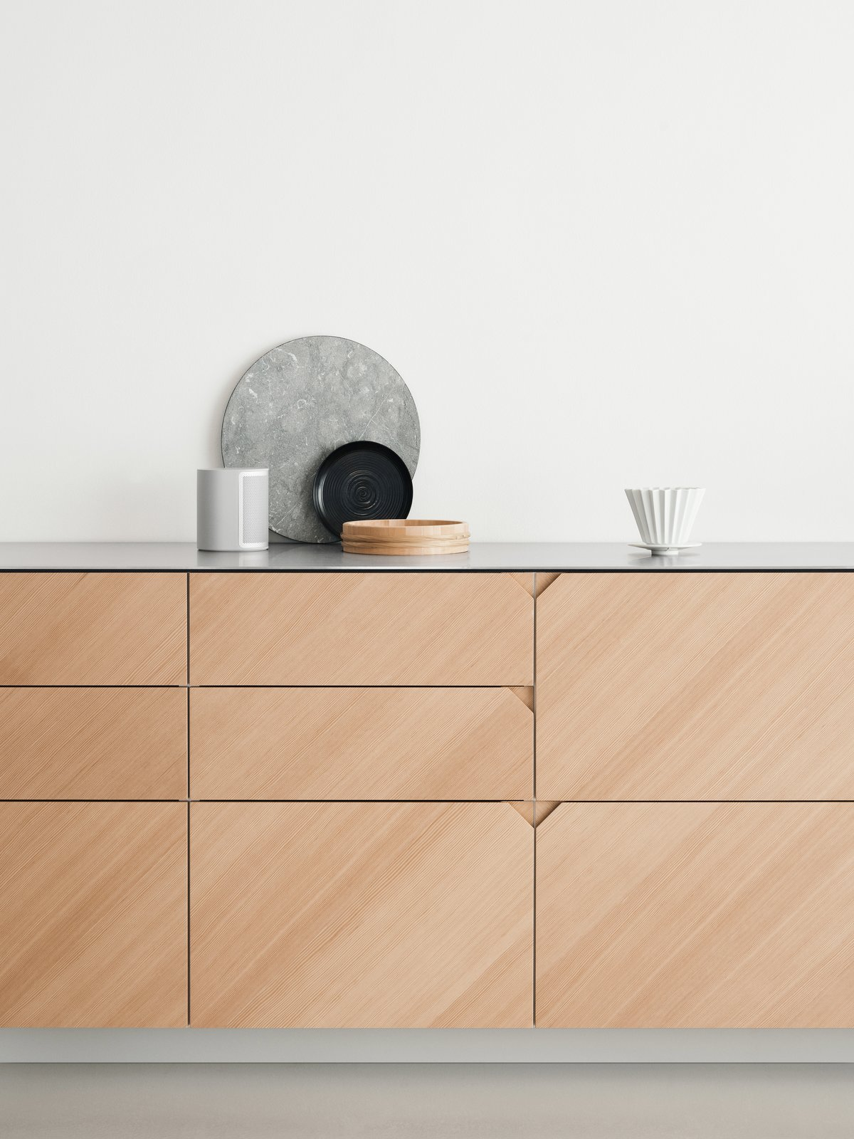 Kitchen, Wood Cabinet, and Metal Counter Oregon Pine is characterized by a light, red-brownish wood color with a fine and narrow wood grain.  Photo 2 of 9 in Here's How You Can Give Your IKEA Kitchen a Fresh Face on a Tight Budget