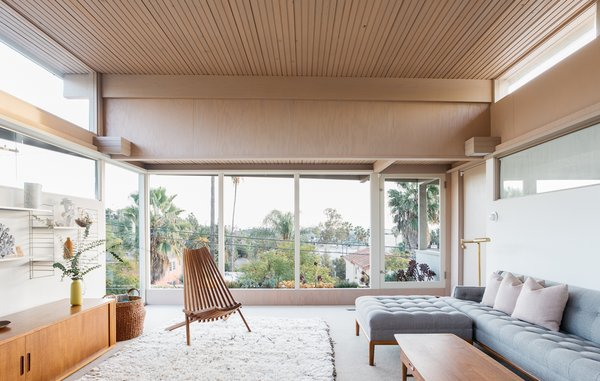 The home is airy and bright—enveloped in natural lighting thanks to large expanses of glass and clerestory windows.