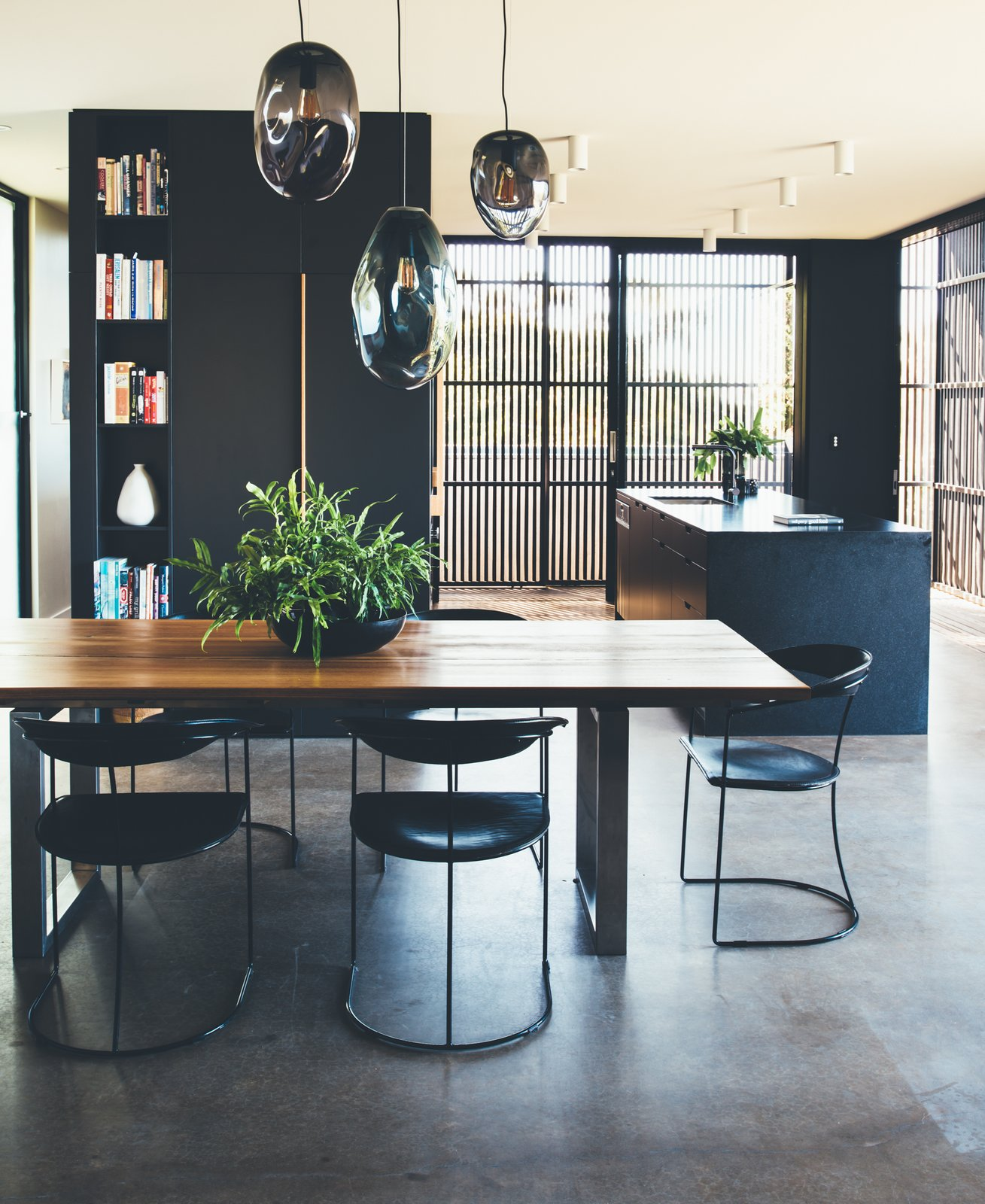 Dining, Table, Pendant, Chair, Ceiling, Concrete, and Shelves Ample natural light enters via the sliding hardwood screens, keeping the interiors bright and airy.  Dining Concrete Table Ceiling Shelves Photos from This Australian Abode Is a Glass Pavilion Wrapped in Sliding Hardwood Screens