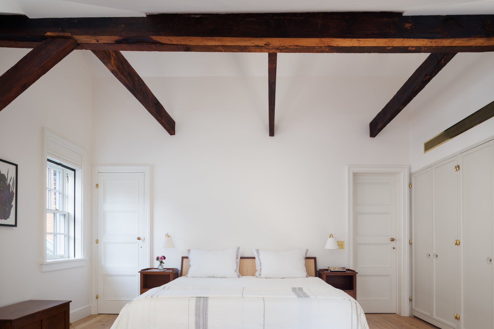 Bedroom, Bed, Night Stands, Wall, Wardrobe, Storage, Light Hardwood, and Bench The wood beams were in poor condition and needed to be cleaned up and treated with oil.   Best Bedroom Bench Night Stands Storage Bed Wardrobe Photos from Before & After: A Historic Tribeca Townhouse Gets a Magical Makeover