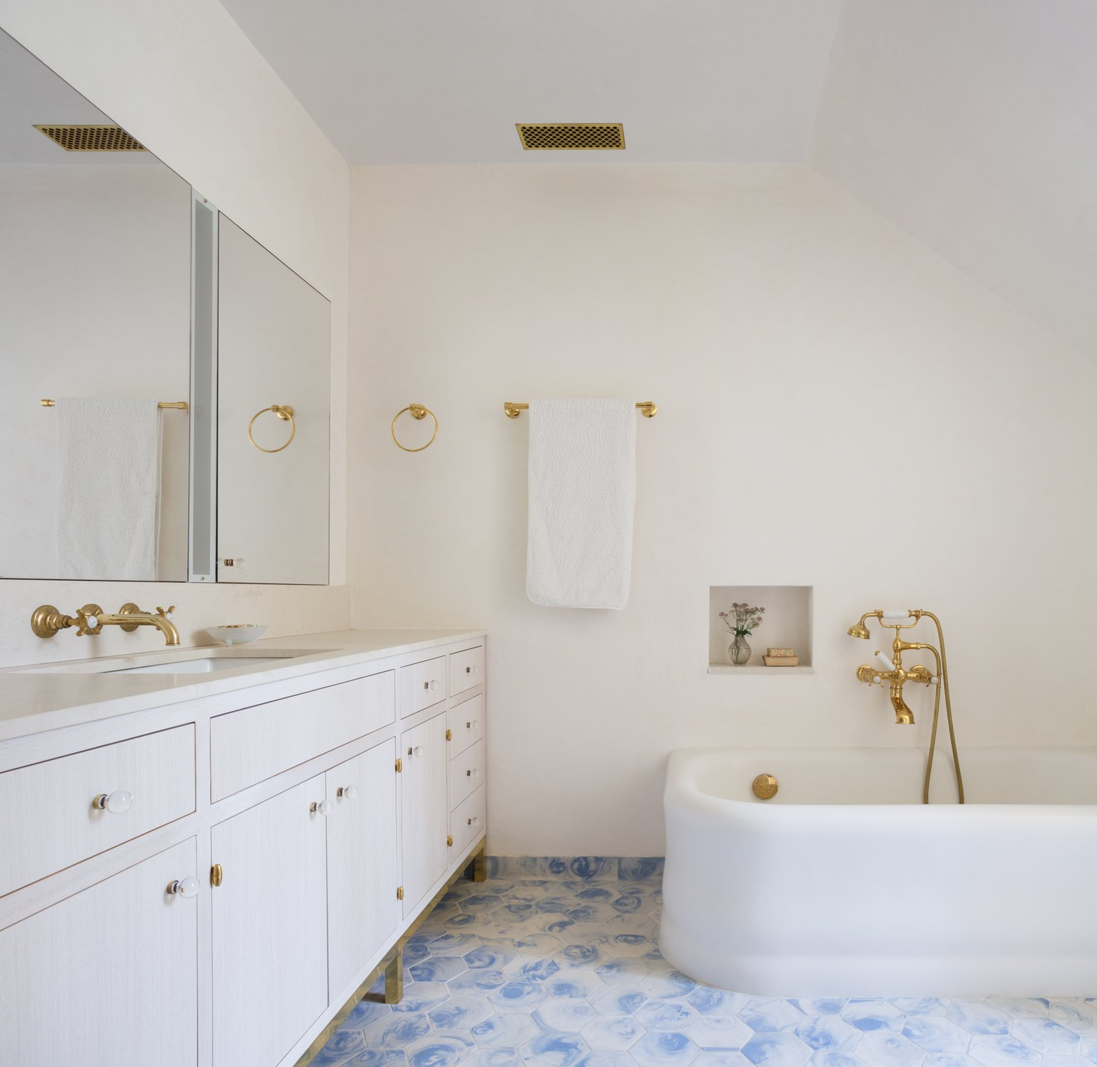 Bath, Ceramic Tile, Undermount, Drop In, Alcove, and Stone When looking to clean your shower liners, soak them in warm water with a little bleach. Don't forget to wipe down countertops and glass mirrors.  Bath Undermount Stone Alcove Photos from Before & After: A Historic Tribeca Townhouse Gets a Magical Makeover