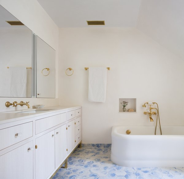 The bathroom in the master suite features a custom made vanity and medicine cabinet
