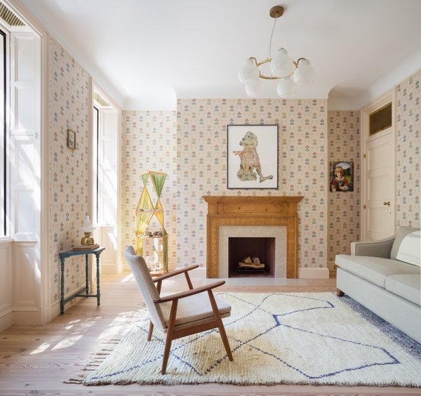 """The sitting room is an updated homage to the past that references the home's history while keeping a distinctly contemporary vibe. """"However, she did want to make one room that felt old,"""" explains Yun."""