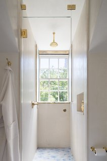 Shower is underneath a dormer, as it was the only way to fit in a shower and a tub.