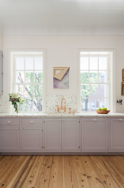 The custom millwork was painted Farrow & Paul Calluna No. 270, which is described as a tranquil lilac and looks light gray according to the light.