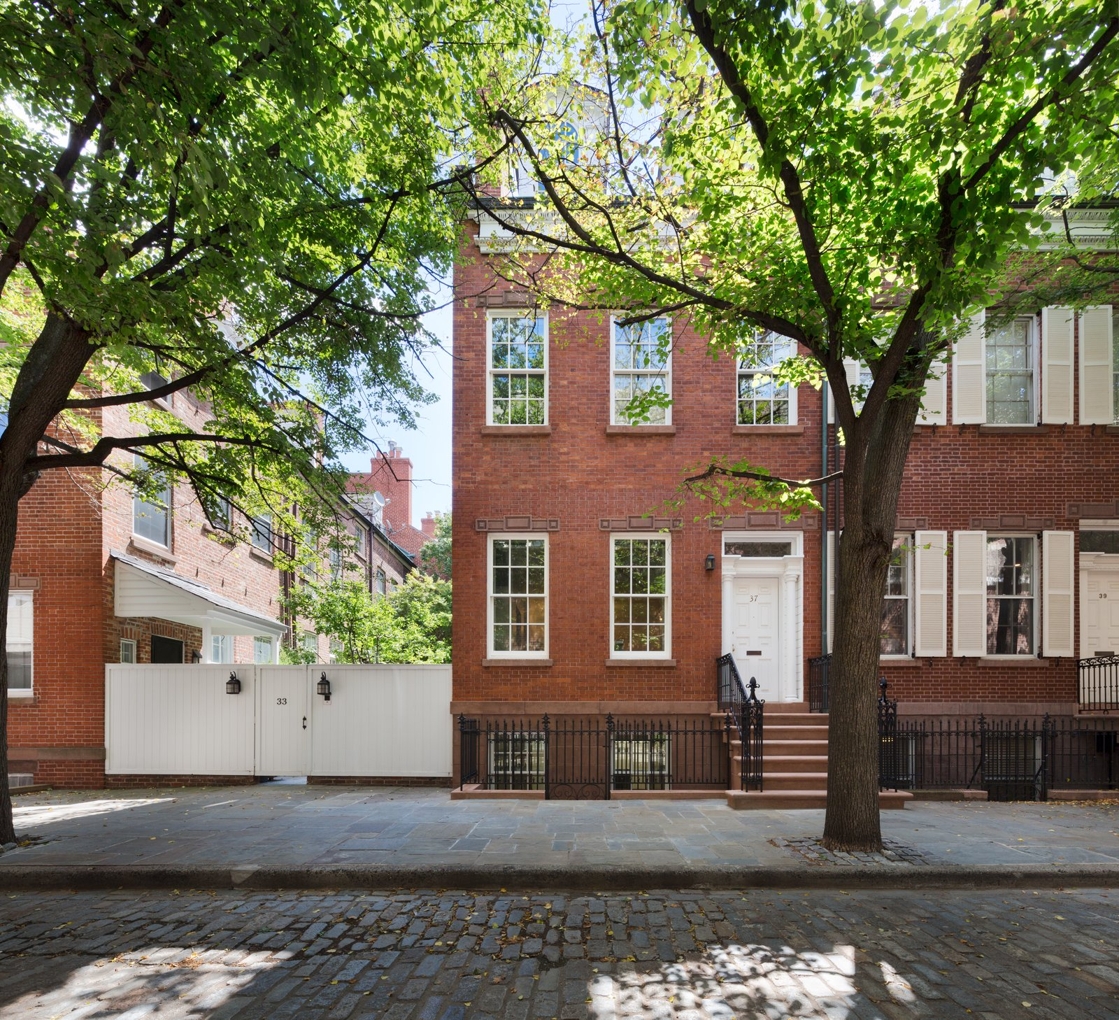 Exterior, Shingles Roof Material, House Building Type, Flat RoofLine, and Brick Siding Material YUN Architecture carefully restored the exterior of the house with new windows, dormers, and wood frames.  Photo 1 of 32 in Before & After: A Historic Tribeca Townhouse Gets a Magical Makeover