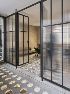 The glass partition doors assist in opening the space up, while also enhancing the natural light.