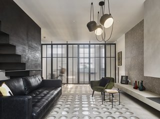 A London Townhouse Has Glass Circles in Its Floors to Filter in Ample Natural Light