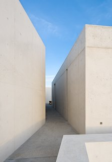 Passageways such as this one allow coastal breezes to pass through the home and provide light and shadow.