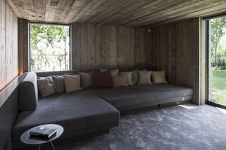 The garden's former wartime bunker has been connected to the property and transformed into a cozy, wood-clad media room.