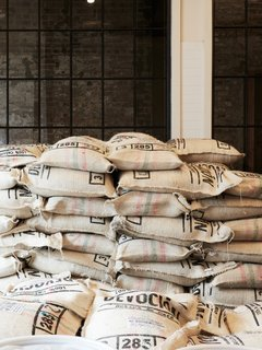 Devoción uses fair-trade coffee beans that are sourced from hand-selected Columbian farms. The beans are dry-milled in Bogota, and shipped to the USA via FedEx for roasting.