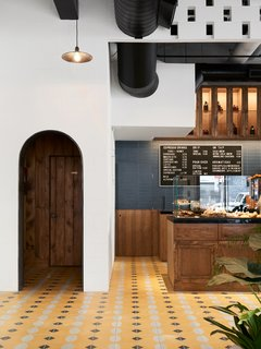 Vibrant handmade cement tiles line the floor.