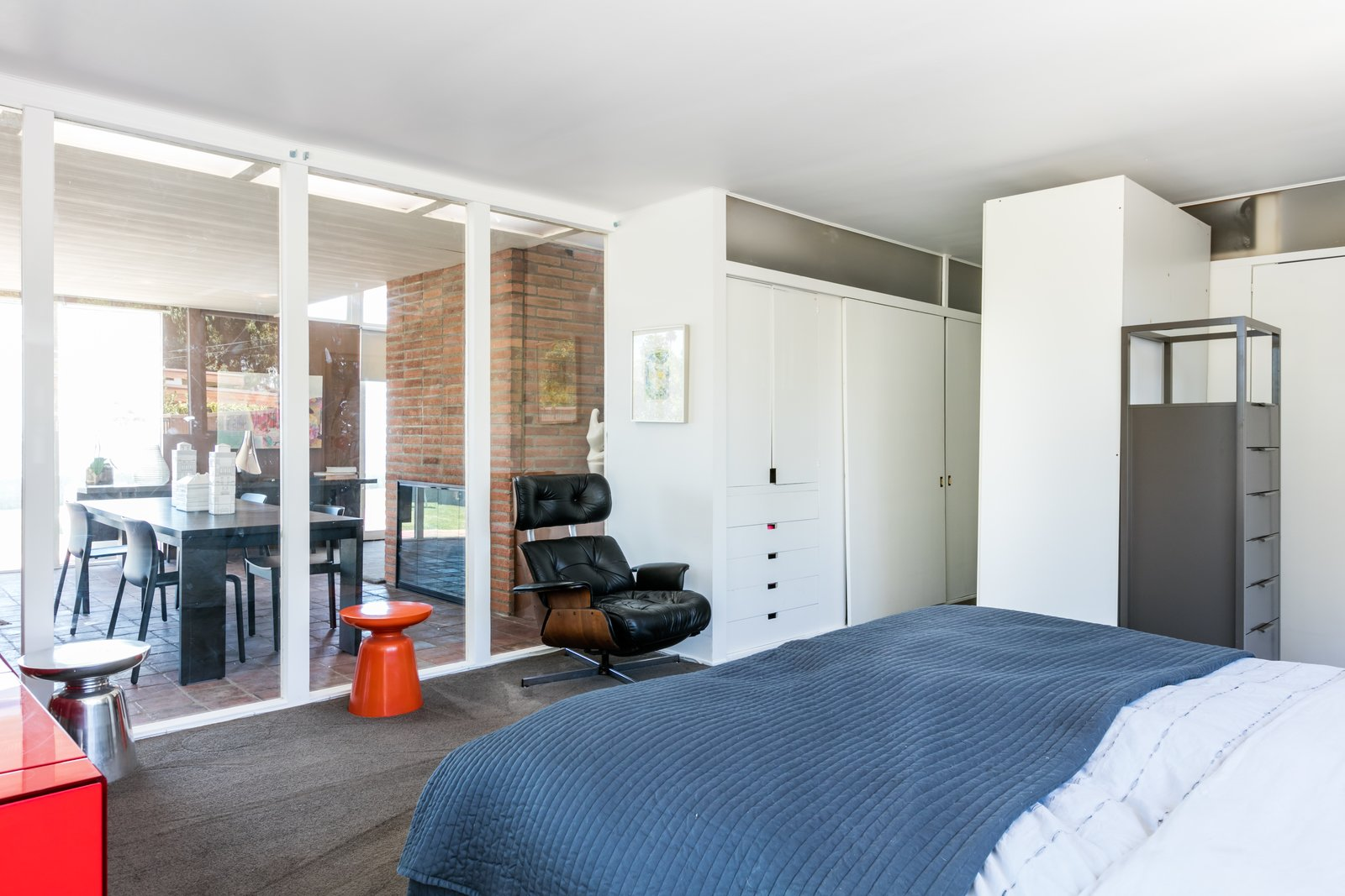 Bedroom, Carpet, Bed, Wardrobe, Storage, and Chair The highlight of this bedroom is ample built-in storage.  Best Bedroom Carpet Chair Wardrobe Bed Photos from Case Study House #18 in L.A. Hits the Market at $10M and Includes Plans From Tom Kundig