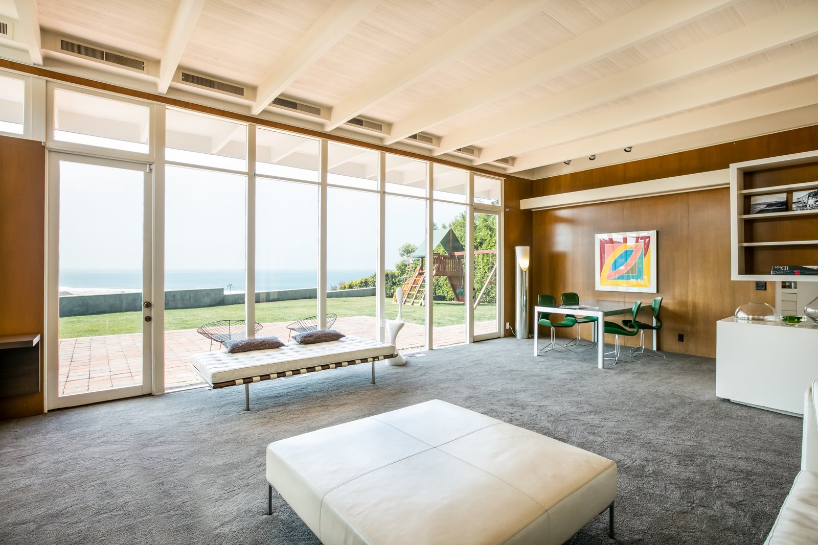 Living, Table, Ottomans, Carpet, Storage, Chair, Floor, Bench, and Track Floor-to-ceiling glazing provides unobstructed views of the ocean.  Best Living Table Ottomans Photos from Case Study House #18 in L.A. Hits the Market at $10M and Includes Plans From Tom Kundig