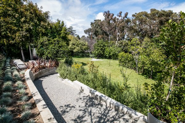 The half acre of land offers a unique opportunity to build a new seperate modern domicile and own a Case Study House—or potentially divide the lot.