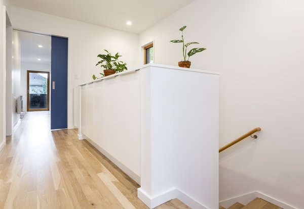 The master bedroom, the child's room, two bathrooms, and an office space are located on the second level. The white cabinets allow for additional storage space.