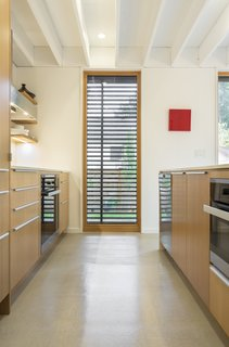 Concrete floors are balanced with natural European Larch windows.