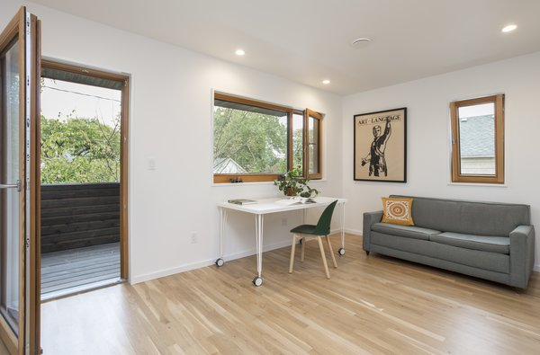 A home office is located on the upper floor at the front of the house with a private balcony that also serves as the covering of the front porch.