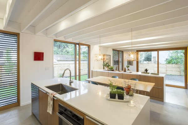 A view from the kitchen. The use of white on the walls and ceilings combined with the glazing provide a great sense of space throughout.