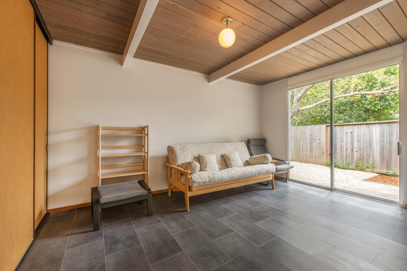 Bedroom, Ceiling Lighting, Laminate Floor, and Chair New Sonos laminate flooring has also been installed in all the bedrooms, bathrooms, kitchen, and office.     Photo 10 of 14 in Live Large in This Extra-Spacious Eichler That's Asking $1.38M
