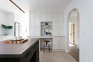 The custom cabinetry includes ample storage and a convenient mini desk.