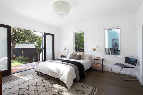 The real gem is the master bedroom which features sliding doors that open to the expansive backyard—perfect for embracing indoor/outdoor living.