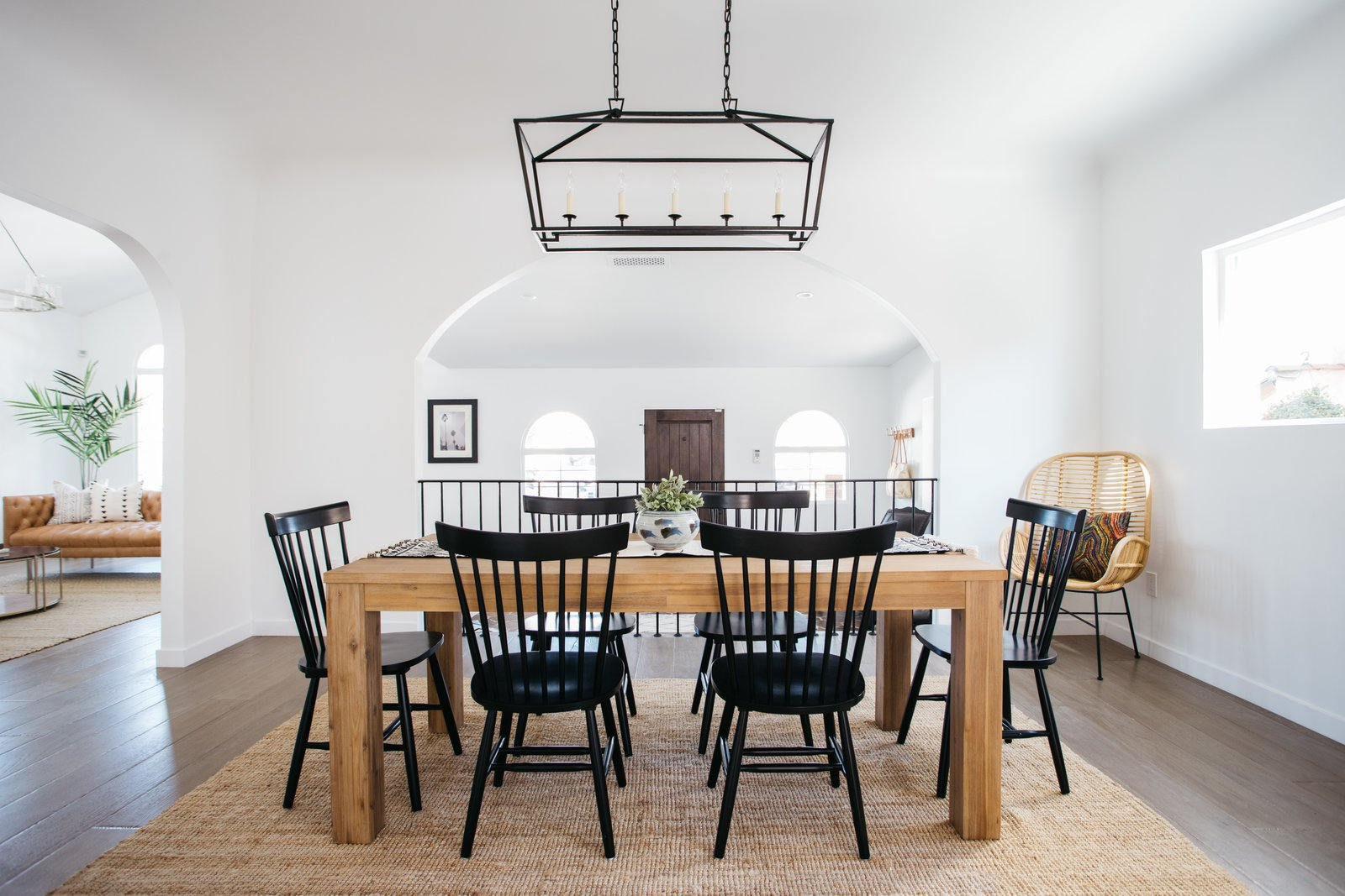 Dining Room, Chair, Table, Medium Hardwood Floor, Rug Floor, and Pendant Lighting A formal dining room sits just off the living area and overlooks the entry.    Photo 6 of 20 in An Updated Spanish-Style Abode with an Artist Studio Hits the Market at $1.1M in L.A.