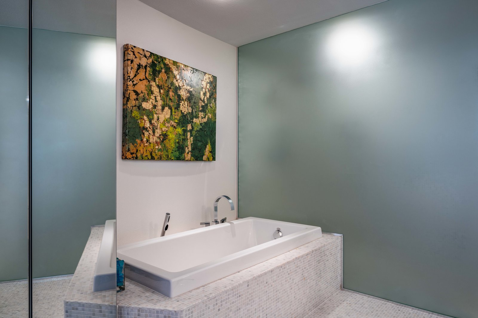 Bath, Porcelain Tile, Alcove, Soaking, and Ceiling A peek at the master bath.     Best Bath Porcelain Tile Alcove Photos from A Circular Midcentury Gem in Florida Hits the Market at $1M