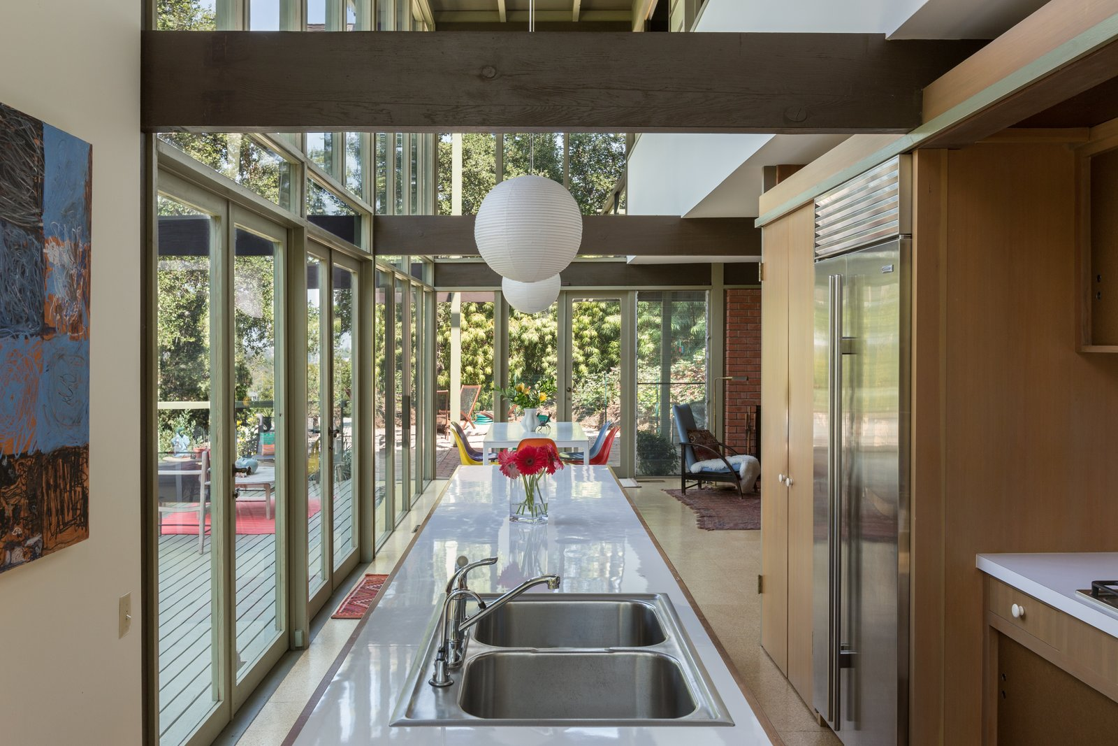 Kitchen, Laminate Counter, Drop In Sink, Refrigerator, Wood Cabinet, and Pendant Lighting The open layout flows from the kitchen into the dining and living areas.  Best Photos from Mad Men Producer Puts His Pasadena Midcentury Up For Auction Starting at $1.7M