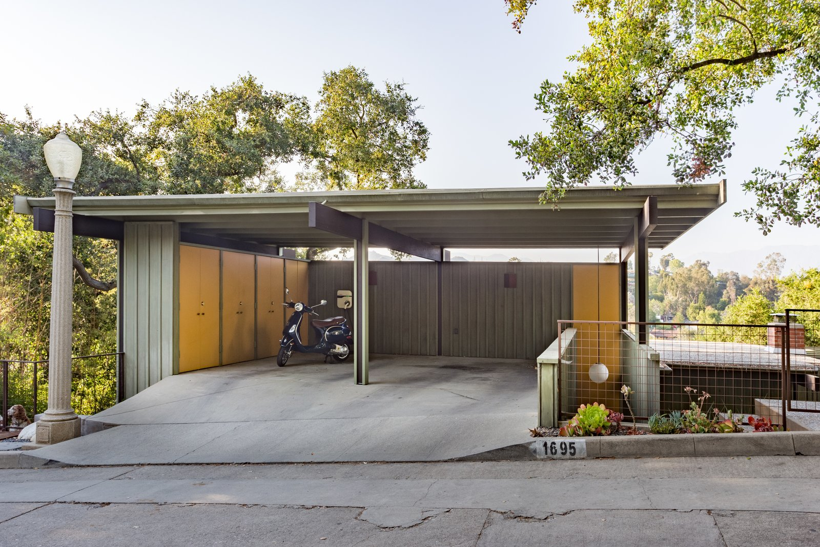 Garage and Detached Garage Room Type The pop of orange as an accent color is picked up in the carport.  Photos from Mad Men Producer Puts His Pasadena Midcentury Up For Auction Starting at $1.7M