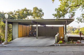 The pop of orange as an accent color is picked up in the carport.