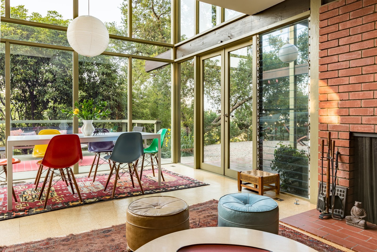 Dining Room, Table, Standard Layout Fireplace, Chair, Pendant Lighting, and Rug Floor Expansive glazing creates a beautiful flow and a strong integration of indoor/outdoor spaces.  Best Photos from Mad Men Producer Puts His Pasadena Midcentury Up For Auction Starting at $1.7M