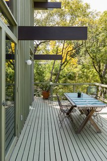 The expansive decks and patios enable indoor/outdoor living and easy entertaining.