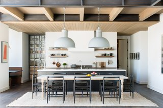 For the kitchen, the homeowner didn't want a lot of closed cabinetry. So while the island features plenty of concealed storage space, she was excited to have open shelves to display a selection of beautiful pieces from her collection.