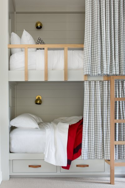 The girls' bedroom was designed for sleepovers and contains four full-size bunk beds and a banquette with a single-size mattress, all custom-designed by ABD Studio.