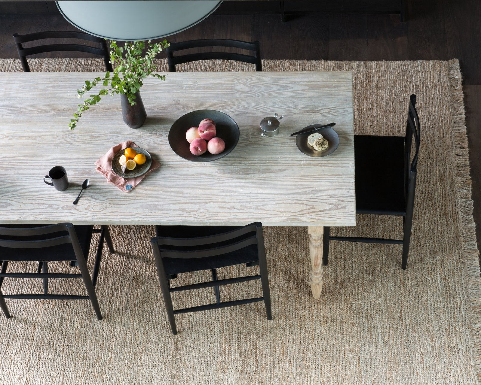 Dining Room, Rug Floor, Pendant Lighting, Chair, Medium Hardwood Floor, and Table The table was designed to patina with age.  Photo 6 of 20 in A Sleek Lake Tahoe Retreat Shows Off an Impressive Art Collection
