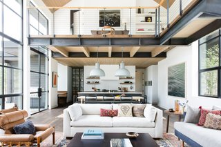 Upon entering the home, guests come into a bright and airy, double-height great room. Part of the challenge for the design was to figure out how to make each space feel separate while making the entire home feel cohesive.