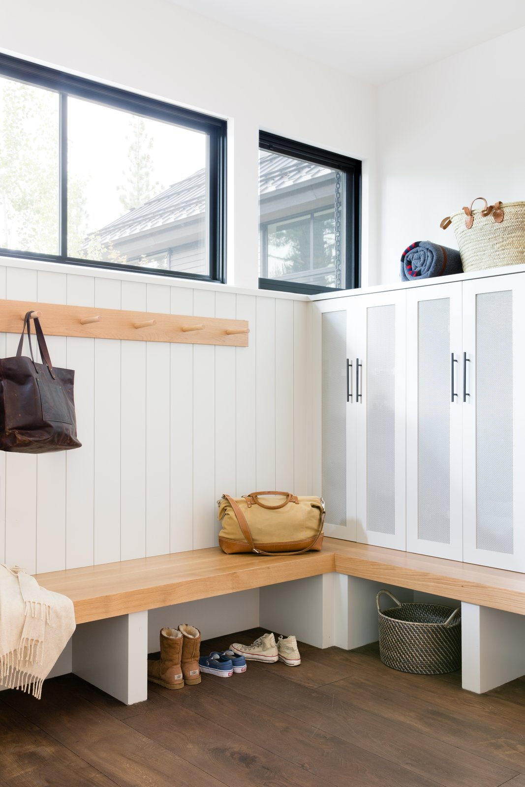 Storage Room and Cabinet Storage Type The mudroom is an essential stop for the family after skiing and other outdoor excursions. Lockers provide neat storage for all their gear.  Photo 10 of 20 in A Sleek Lake Tahoe Retreat Shows Off an Impressive Art Collection