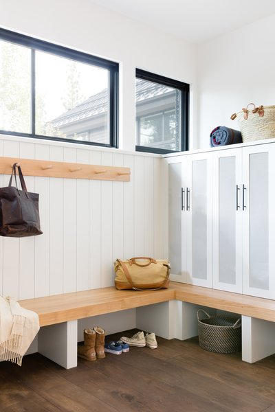 The mudroom is an essential stop for the family after skiing and other outdoor excursions. Lockers provide neat storage for all their gear.