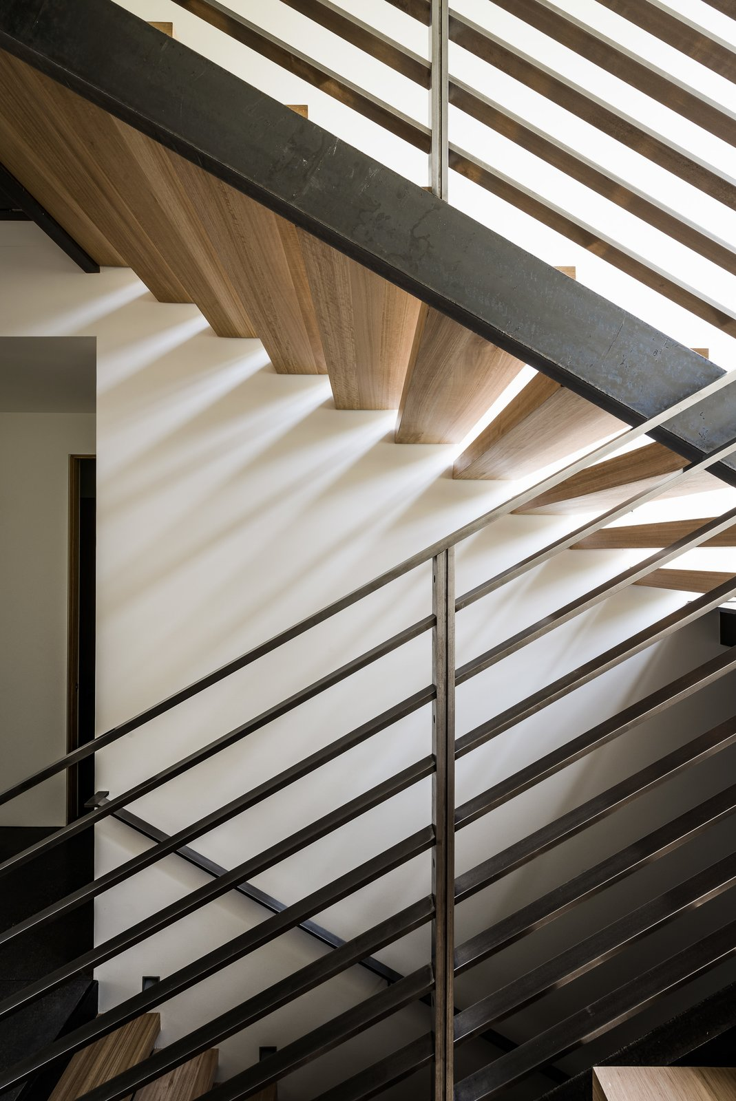 Staircase, Wood Tread, and Metal Railing The staircase also plays with the concept of gaps and slices.  Photo 11 of 18 in An Uplifting Lake Tahoe Retreat Uses Light as a Building Material