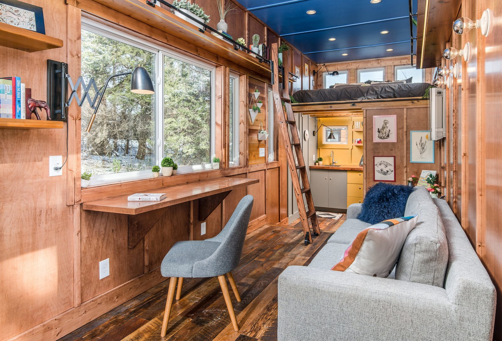 """Living, Recessed, Medium Hardwood, Desk, Shelves, Wall, Sofa, and Chair """"Cornelia is a real rock star,"""" says Latimer of his client-turned-friend. """"She is one of the most amazing people I have ever met.""""   Living Desk Wall Photos from This Tiny Home and Writing Studio Was Invented for a Children's Author"""