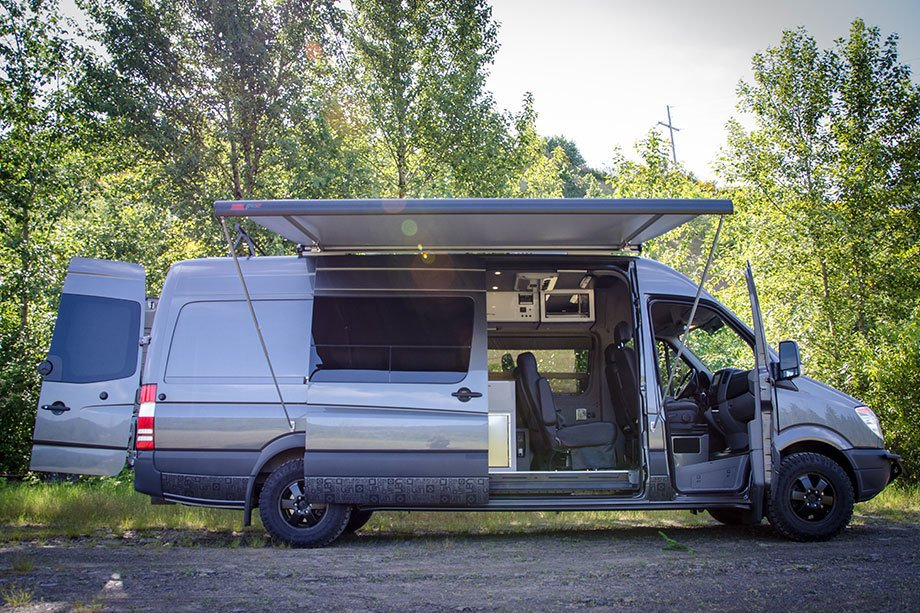 Exterior and Camper Building Type  The captain's chairs swivel to create additional seating, and there is even room for gear.     Photo 6 of 14 in 7 Van Conversion Companies That Will Do the Legwork For You