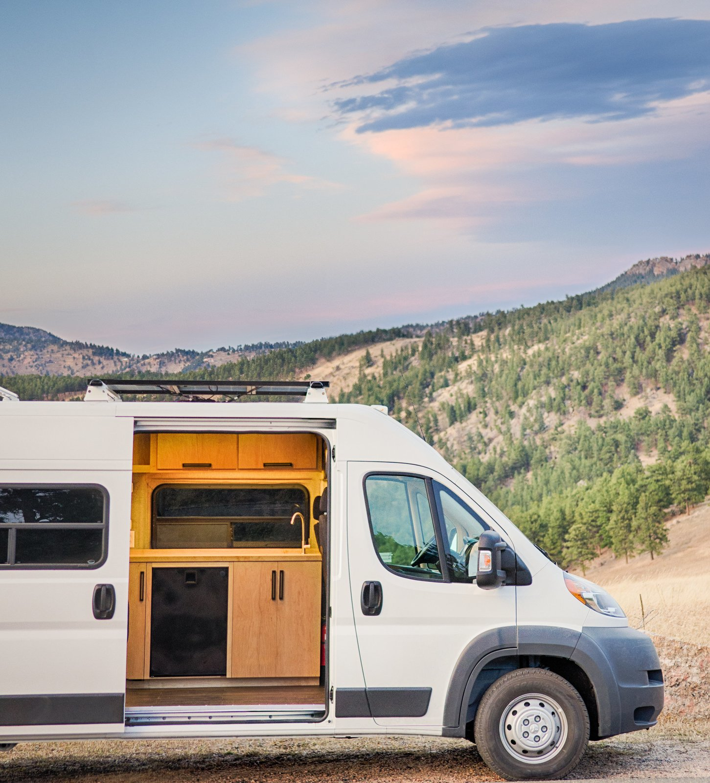 Exterior and Camper Building Type This model features clean, simple interiors, along with a roof rack that houses 300W of Renogy Eclipse solar panels.     Photo 11 of 14 in 7 Van Conversion Companies That Will Do the Legwork For You