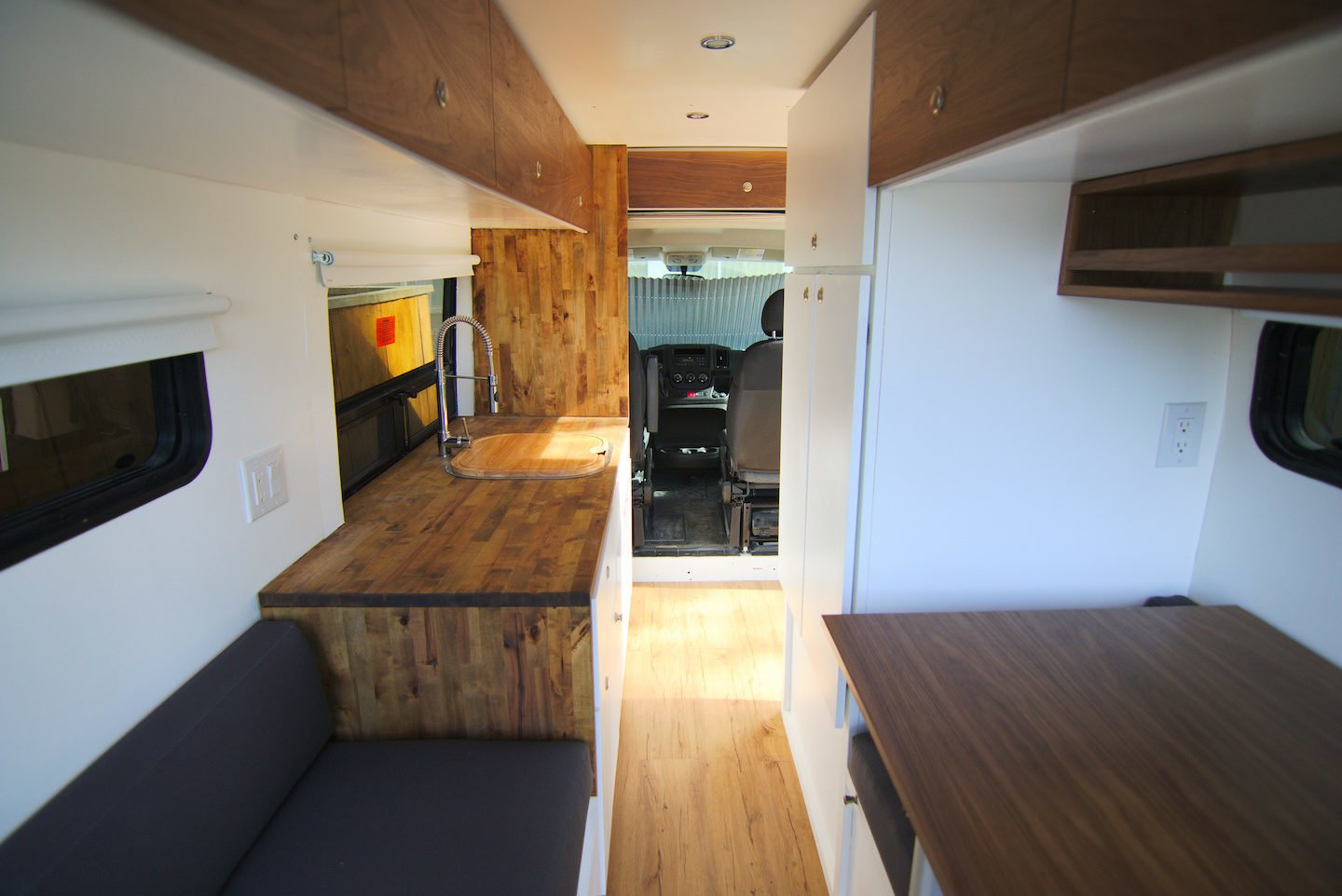 Kitchen, Drop In Sink, Light Hardwood Floor, and Recessed Lighting The Alaska model features beautiful woodwork throughout and starts at $42,500, depending on customizations.    Photo 13 of 14 in 7 Van Conversion Companies That Will Do the Legwork For You