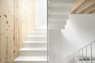 Thanks to the crisp neutral shade, the staircase carries light from floor to floor.
