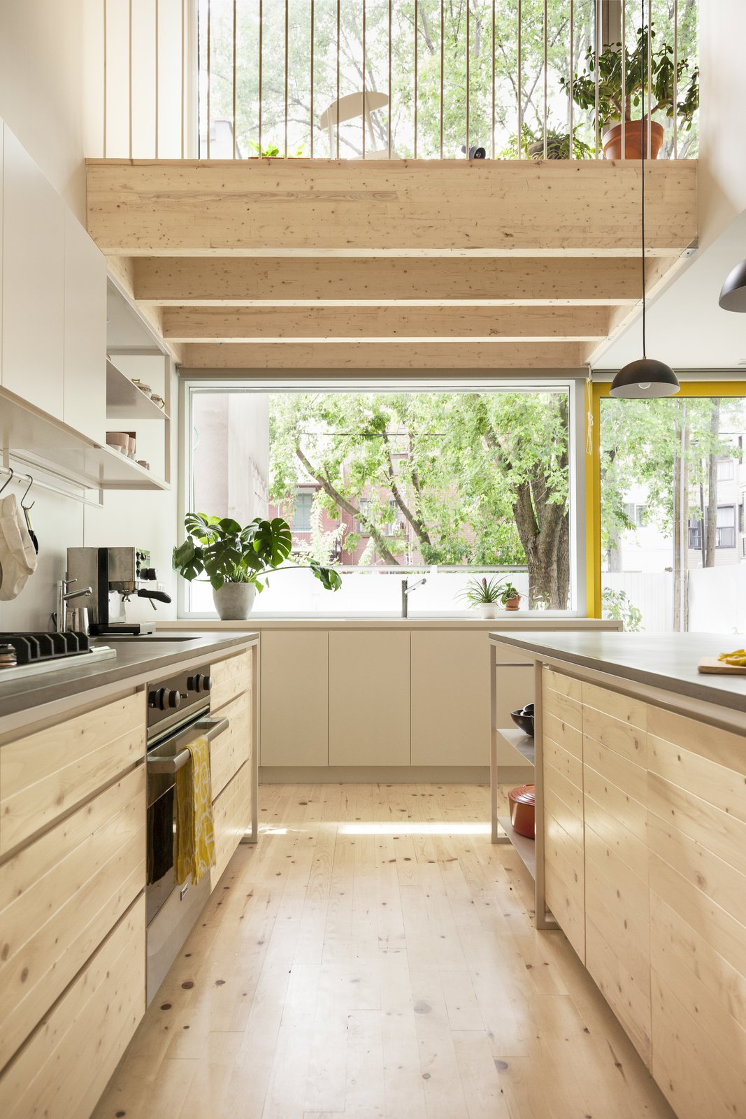 Kitchen, Wood Cabinet, Pendant Lighting, Light Hardwood Floor, Cooktops, Wall Oven, and Undermount Sink Pine has also been used in the ceiling beams.     Photo 4 of 8 in 7 Natural Cleaning Recipes You Can Whip Up in Minutes